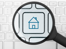 House icon under the magnifying glass Royalty Free Stock Image
