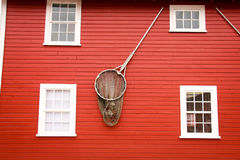 House at Icy Strait Point in Alaska. Red fisherman's house with a fishing net on the outside as decoration, showing of the occupiers profession Stock Images