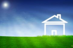 House imagination on green land Stock Photos