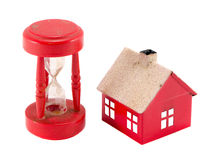 House imitation broken sandglass isolated on white Stock Photo