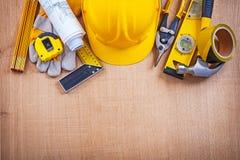 House improvement tools on oak wooden board Royalty Free Stock Photos