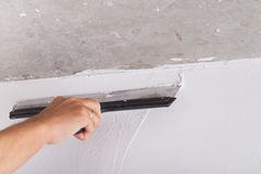 House improvement. worker puts finishing layer of stucco on wall Stock Images