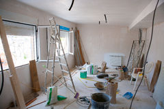 House indoor improvements in a messy room construction. With plaste tools and ladder royalty free stock image
