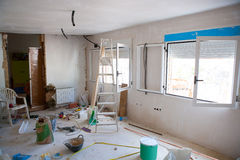 House indoor improvements in a messy room construction. With plaste tools and ladder royalty free stock photo