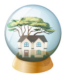 A house inside the crystal ball Stock Images