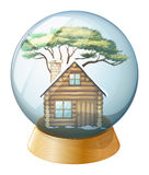 A house inside the crystal ball Royalty Free Stock Image