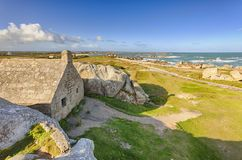 Ancient customs house between rocks at Menez-Ham, Brittany Royalty Free Stock Photography