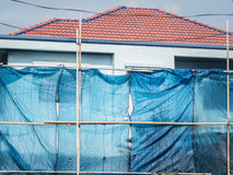 The house installs scaffold for construction with slan Stock Image