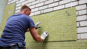 House insulation - insulating house facade with mineral rock wool stock video