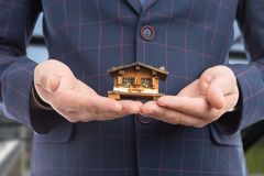 House insurance concept with hands holding house. House insurance concept with close-up of businessman hands holding house for protection and safety Royalty Free Stock Photos