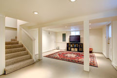 House interior. Basement room with TV Stock Images