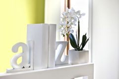 House interior decoration using 3d letters and flowering plant Royalty Free Stock Image