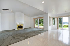 House interior. Empty living room with fireplace and walkout dec stock photo