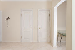 House Interior. Entrance Hallway With White Doors To Walk-in Closet And Toilet. Stock Images