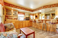 House interior. Open floor plan. Kitchen and dining area Royalty Free Stock Image