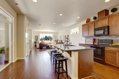 House interior with open floor plan. Kitchen room wiht island Royalty Free Stock Photography