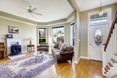 House interior with open floor plan. Living room and entrance ha royalty free stock photo