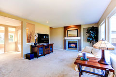 House interior with open floor plan. Living room with fireplace Stock Photo