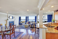 House interior with open floor plan. Living room with walkout deck, dining and kitchen area royalty free stock photography