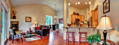 House interior. Open floor plan panoramic view. Living room with dining area and kitchen. Panoramic view of open floor plan royalty free stock photo