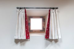 House interior - A small window with curtains royalty free stock photo
