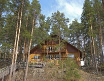 House inthe mountains. House between the trees in the mountains Royalty Free Stock Photos