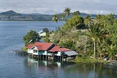 House on an island on the lake of Sentani Stock Photography