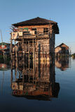 A house and its reflection on Inle Lake Stock Photo