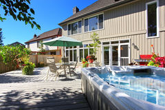 House with jacuzzi on backyard Stock Photos