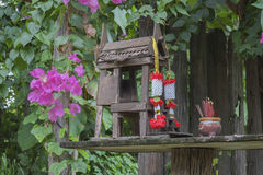 House joss spirit thailand. Culture asia spirits religion thai buddhism shrine beautiful country garland sticks decoration concept colorful lifestyle home Stock Photo