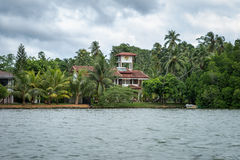 The house among the Jungle on the River Bank. Sri Lanka. Bentota - August 15, 2015. The vicinity of Bentota. The house among the Jungle on the River Bank Stock Photos