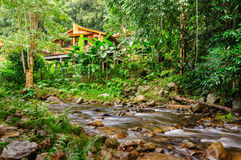House in jungle and stream Royalty Free Stock Photo