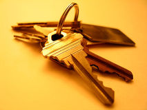House Key. Warm tones. Focus on key in the front royalty free stock photography