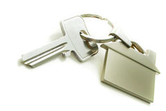 House Key. View of silver key with house figure on the white Royalty Free Stock Photo