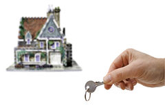 House and key. House or home with hand and key, a new home isolated on white background Royalty Free Stock Photo