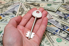 House key above american one hundred dollar Stock Photography