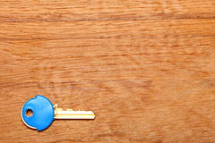 House key with blue plastic coats caps on table Royalty Free Stock Image