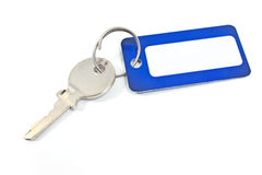 House key with blue tag. Isolated on white Stock Images