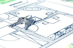 House key on a blueprint. Relocate concept stock photos