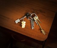 House key in bunch with trinkets Royalty Free Stock Image