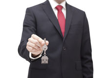 House key in businessman hand. With clipping path Stock Image