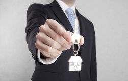 House key in businessman hand Stock Photography