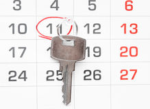 A house key on a calendar background Royalty Free Stock Photography