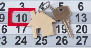 A house key on a calendar background Stock Image