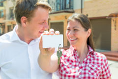 House key on clean white card and a couple Stock Image