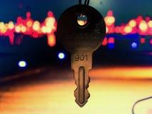 House key in the door stock photo