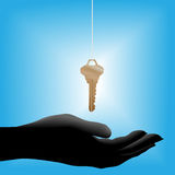 House key drops in cupped hand Royalty Free Stock Photography
