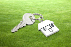 House key on grass background Stock Image