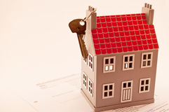 House and key. Gray house with red roof layout and key Stock Photo