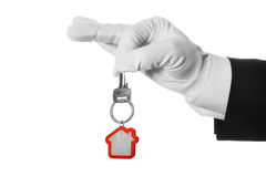 House key in hand butler. On white background Royalty Free Stock Photos